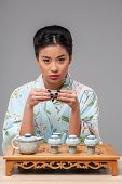 Enjoying asian tea ceremony