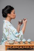 Asian woman preparing tea ceremony