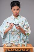 Japanese woman preparing tea ceremony