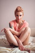 Fitness woman with a beautiful body and tattoo. Sexy glamorous blonde.