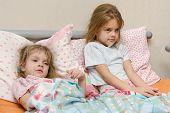 Two Girls Sick Meryat Temperature