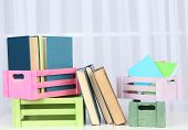 Many books in crates on light background