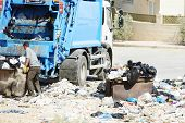 picture of dump_truck  - Garbage truck collecting trash - JPG
