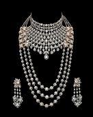 stock photo of diamond  - Close up of diamond necklace on black background with diamond earrings - JPG