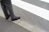 Man Legs In Slag Pants Waiting To Cross The Street At A Crosswalk