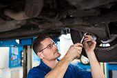 Focused mechanic adjusting the tire wheel at the repair garage