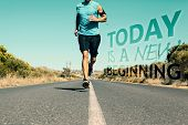 Athletic man jogging on open road against today is a new beginning