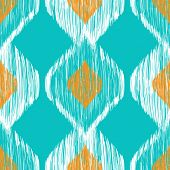 Ikat ethnic seamless pattern in blue and yellow colors