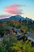 Lijiang Old Town with local historical architectures and Jade Dragon Snow Mountain