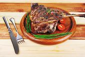 ready to eat grilled ribs on wooden plate