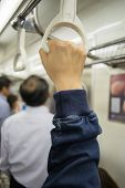 Hand Of Passengers Hold On Rail Handle Of Transit System