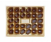 Chocolate pralines in the golden box, isolated on white