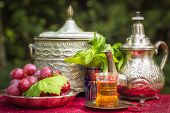 stock photo of oasis  - Oasis dream with mint tea and red grapes - JPG