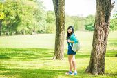 picture of knapsack  - Woman in park outdoor with knapsack Beautiful woman in the park - JPG