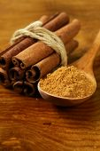 pic of cinnamon sticks  - fragrant cinnamon sticks and ground spices on a wooden background - JPG