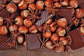 image of hazelnut  - Chocolate star anise and hazelnuts on a wooden background - JPG