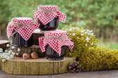picture of three life  - Still life with three jars of jam and decoration in rustic style - JPG