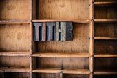 foto of tithe  - The word TITHE written in vintage wooden letterpress type in a wooden type drawer - JPG