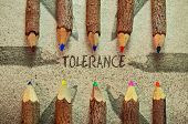 picture of racial discrimination  - Conceptual image with pencils on vintage background as an appeal for tolerance - JPG