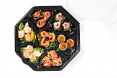 stock photo of buffet lunch  - buffet box with cover set catering canape isolated - JPG