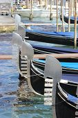 picture of gondola  - Gondolas Gondolas lined up  on the Grand Canal in Venice Italy - JPG