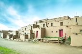 foto of pueblo  - Adobe settlement represents the culture of the Pueblo Indians of Arizona and New Mexico USA - JPG