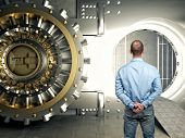 picture of vault  - standing businessman look modern vault - JPG