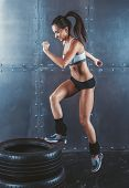 image of jumping  - Sporty active fit woman box jumping - JPG