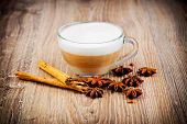 pic of cinnamon sticks  - Cup of coffee latte and cinnamon stick on wooden background - JPG