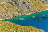 foto of greek-island  - Fish farms with cages in sea bay on Greek Island - JPG