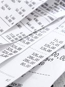 stock photo of receipt  - cash register receipts in a pile - JPG