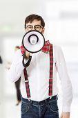 picture of suspenders  - Funny man wearing suspenders shouting with megaphone - JPG