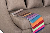 image of no clothes  - Stylish couch and cushions in beige basket weave cloth and cloth colour samples for home and office interior - JPG