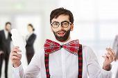 foto of menstruation  - Surprised man wearing suspenders with menstruation pad - JPG