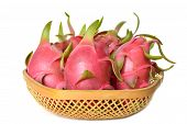 stock photo of epiphyte  - Dragon fruit in bamboo basket - JPG