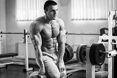 foto of abdominal muscle  - A man pumping abdominal muscles in the gym - JPG