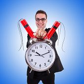 stock photo of bomb  - Man with time bomb isolated on white - JPG