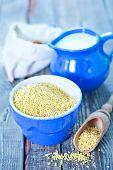 image of porridge  - millet porridge in bowl and on a table - JPG