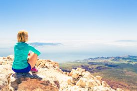 picture of motivation  - Young woman looking and meditation outside natural beautiful inspirational landscape environment fitness and exercising motivation and inspiration in sunny mountains over blue sky and ocean sea - JPG
