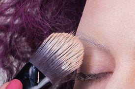 foto of face-powder  - Application of powder on the model - JPG