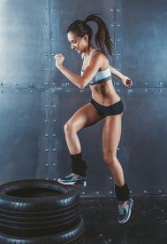 picture of jumping  - Sporty active fit woman box jumping - JPG