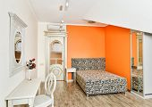 Modern Bedroom In Bright Orange Colors With Zebra Patterned Bed