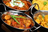 Indian curries in balti serving dishes