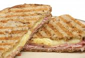 Toasted pressed sandwich or panini with ham and cheese.