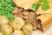 Chicken pie with new potatoes and peas.