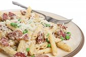Rigatoni pasta with pancetta, ricotta and peas.