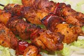 Spanish marinated chicken and chorizo kebabs.