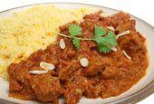 Indian Rogan Josh lamb curry with pilau rice.