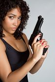 Beautiful black woman holding gun