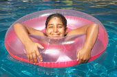 Young girl floating in an inner tube